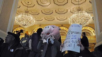 "Mellon pig ""One Pittsburgh"" protesters leave the Omni William Penn during BNY Mellon's shareholder meeting today."