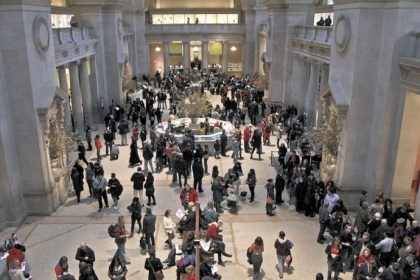 Metropolitan Museum of Art Visitors to the Metropolitan Museum of Art in New York City congregate in the main lobby. The museum draws more than 6 million people a year.