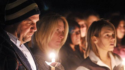 Michael Schaab's family Michael Schaab's family attends a vigil marking his killing. From left are his father, Harry, his mother, Mary, and his fiancee, Megan Shively.