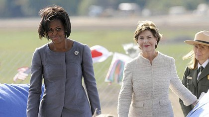 Michelle Obama and Laura Bush First Lady Michelle Obama and former First Lady Laura Bush take to the podium together at the Flight 93 National Memorial ceremony in Shanksville today.