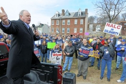 Mike Doyle speaks to rally U.S. Rep. Mike Doyle, D-Forest Hills, speaks Sunday to a rally of nearly 200 people gathered on the North Side to hear union leaders and public officials voice support for postal workers and continuing Saturday mail delivery.