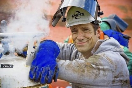 "Mike Rowe Mike Rowe next to venting gas on torch bottles at Cash's Scrap Metal in St. Louis during one of the episodes of ""Dirty Jobs"" on the Discovery Channel."