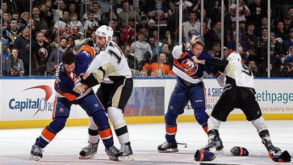 Mike Rupp, Pascal Dupuis, Josh Bailey and Travis Hamonic Islanders defenseman Travis Hamonic fights Penguins forward Michael Rupp (right) as Islanders forward Josh Bailey battles Penguins forward Pascal Dupuis during the second period of a game Feb 11, 2011 at Nassau Coliseum in Uniondale, New York. The teams meet again tonight.