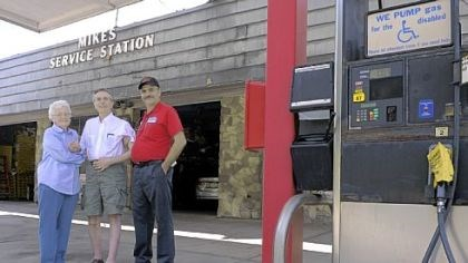 Mike's Service Station Dorothy Genser, 90, poses June 19 with her sons Ron Genser, center, and Rick Genser at the family-owned gas station, Mike's Service Station, on Route 8 in Shaler. Partly because government regulations have become too costly, the Gensers will stop selling gasoline at the end of June at the station that has been in their family since 1928. They plan to continue operating A-Advantage Truck & Trailer, the service and parts businesses housed at the gas station, as well as the A-Advantage Gun Shop.