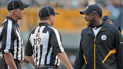 Mike Tomlin Steelers head coach Mike Tomlin has words with Greg Wilson, the back judge, and Gary Cavaletto, the field judge, during Sunday's game against Oakland.