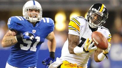 Mike Wallace Steelers' Mike Wallace hauls in touchdown pass from Roethlisberger in the first half against the Colts.