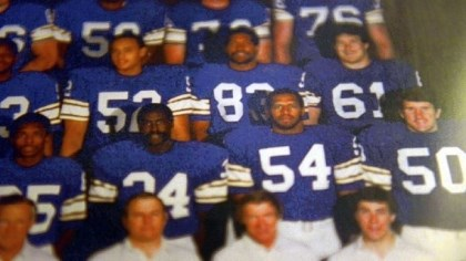 Minnesota Vikings Fred McNeill (No. 54) stands with the rest of the Minnesota Vikings in a 1982 team photo.