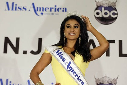 Miss America 2014 Miss New York Nina Davuluri poses for photographers following her crowning as Miss America 2014 on Sept. 15 in Atlantic City, N.J.