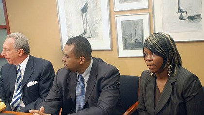 Mitchell family Theresa Thornton, right, daughter of Curtis Mitchell, who died in February after 10 calls made to 911 during a winter storm, sits with attorneys Alan Perer, left, and Paul Ellis during a news conference Thursday about a lawsuit filed against the city of Pittsburgh.