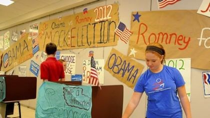 Mock 3 Madison Zimmer, a sophomore at Chartiers Valley High School, casts her vote in the school's mock presidential election. David Harhai's Advanced Placement U.S. Government and Politics class organized the election.
