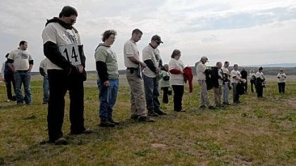 Moment of silence Volunteers observe a moment of silence in memory of those who died in the 9/11 terrorist attack before planting tree seedlings at the Flight 93 National Memorial in Stonycreek, Somerset County, on Saturday.