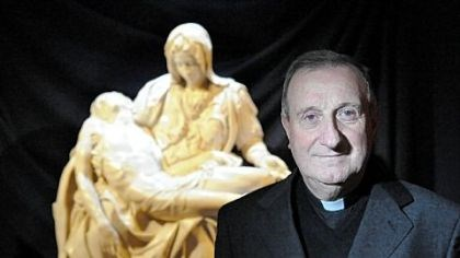 "Monsignor Roberto Zagnoli, curator of the ""Vatican Splendors"" exhibition Monsignor Roberto Zagnoli, curator of the ""Vatican Splendors"" exhibition, stands in front of a cast replica of the ""Pieta,"" one of Michelangelo's masterpieces in the show."