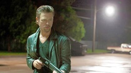 "Movie review: Brad Pitt portrays professional hit man Jackie Cogan in ""Killing Them Softly."""
