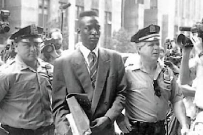 "Movie review: 'Central Park Five' Defendant Yusef Salaam walks into courthouse flanked by police officers in ""The Central Park Five."""