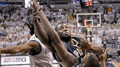 Muscles all the way DeJuan Blair muscles his way over Georgetown's Greg Monroe for one of his 17 rebounds yesterday in Pitt's dominating performance at the Verizon Center in Washington.