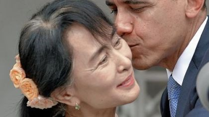 Myanmar President Barack Obama kisses Myanmar opposition leader Aung San Suu Kyi after speaking to the media following their meeting at her residence in Yangon on Monday.