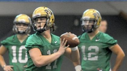 Myers Pitt quarterbacks Trey Anderson (10) and Tino Sunseri (12) watch as Mark Myers works a passing drill Thursday on the first day of spring practice.