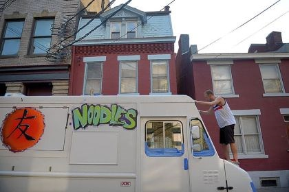 Nakama food truck Artist Danny Gardner, 26, of the South Side, spray paints the new Nakama food truck outside the restaurant. The truck will make its debut on Thursday, July 18 at the Pittsburgh Vintage Grand Prix in Schenley Park.