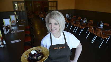 Nancy Sukits Nancy Sukits, owner of MAC Diner in Hampton, holds creme brulée French toast with a berry compote. Her restaurant opened in Over the summer.