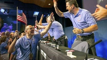 NASA members celebrate Above, at NASA?s Jet Propulsion Laboratory in Pasadena, Calif., Mars Science Laboratory team members Miguel San Martin, left, and Adam Steltzner celebrate early Monday after the successful landing of the United States? Curiosity rover on the surface of Mars.