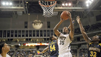 Nasir Robinson Pitt's Nasir Robinson drives to the net against Marquette in the first half of Saturday's game at the Petersen Events Center.