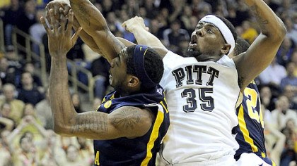 Nasir Robinson and John Flowers Pitt forward Nasir Robinson gets tangled up with West Virginia forward John Flowers in the first half of Friday's game at the Petersen Events Center.