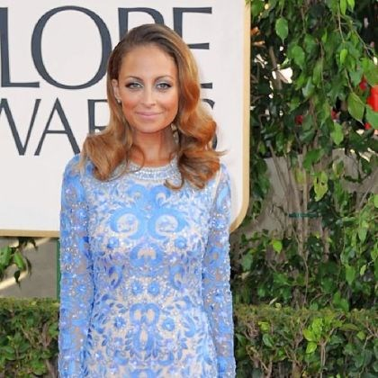 Nicole Richie on red carpet Nicole Richie attended the Golden Globes wearing a saturated pale blue gown by Naeem Khan.