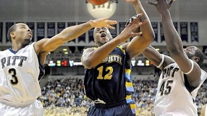 No. 3 Pitt 90, No. 13 Marquette 75 Jermaine Dixon and DeJuan Blair fight for a loose ball with Marquette's Dwight Burke in the second half last night.