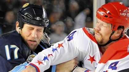 "No secret Penguins' Michael Rupp: ""There's no secret that we don't like each other."" Shown here, the Capitals' John Erskine lands a right cross on Rupp in their clash in the first period at Heinz Field last night."