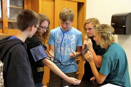 Norwin students Learning about measuring blood pressure are Norwin students, from left: Ian Swets, Ashley White, J. Caleb Swanson, Madison Skarja. With them is nursing student Megan Seibel, right.