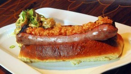 Not an ordinary hot dog At Eleven Contemporary Kitchen, the hot dog is made from prime beef and local pork jowls from Penn's Corner Farm Alliance. Paprika, nutmeg, coriander, pepper, garlic and dry mustard add even more flavor.