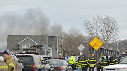 ny fire shooting Smoke is seen from the site of a fire in Webster, N.Y., today. Police say a man who killed two firefighters in a Christmas Eve ambush had served 17 years for manslaughter in the death of his grandmother.