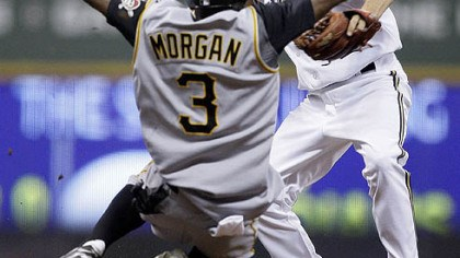 Nyjer Morgan Nyjer Morgan breaks up a double play as he slides into Brewers shortstop J.J. Hardy during the seventh inning of yesterday's game in Milwaukee. The Pirates' Freddy Sanchez was safe at first.