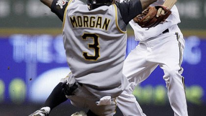 Nyjer Morgan Nyjer Morgan (3) breaks up a double play as he slides into Milwaukee Brewers shortstop J.J. Hardy during the seventh inning of yesterday's game in Milwaukee. The Pirates' Freddy Sanchez was safe at first.