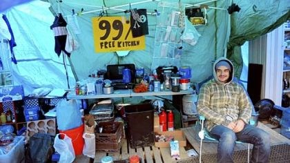 Occupy Pittsburgh Occupy Pittsburgh protester Mike Klaiber of the South Side sits inside the kitchen tent at Mellon Green on Grant Street, Downtown, on Friday. The group plans to begin winterizing its encampment this weekend.