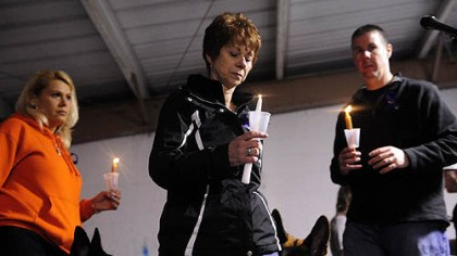 Officer's mother at vigil Bev Kuzak, center, mother of Clairton office James Kuzak, who was shot on duty, leads a candle vigil at Memorial Park in Clairton.