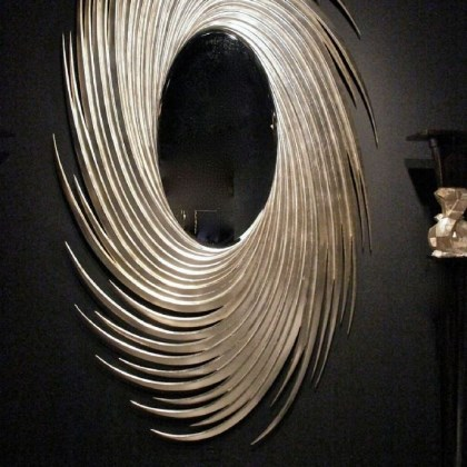 'Oliver' mirror Oliver mirror by Christopher Guy inspired a hat worn by Duchess Camilla Bowles.