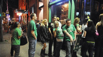 On Carson Street St. Patrick's Day revelers line up to get into Town Tavern on the South Side last week.