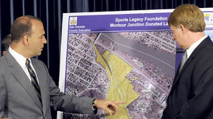 Onorato shows Montour Junction Allegheny County Chief Executive Dan Onorato views a map showing the 78 acres known as Montour Junction, donated by the Sports Legacy Foundation for a new county sports and athletic complex.