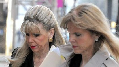 Ories State Sen. Jane Orie, right, arrives at the courthouse Tuesday with her sister Janine.