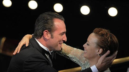 "Oscars - Best actor Jean Dujardin is congratulated by Berenice Bejo before accepting the Oscar for best actor for ""The Artist."""