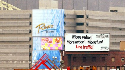 our casinos The Mountaineer Gaming Resort has a billboard in front of the Rivers Casino on the North Shore.
