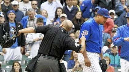 Outta here ... Home plate umpire Mark Carlson, left, ejects Chicago Cubs' starting pitcher Carlos Zambrano, center, as Cubs manager Lou Piniella, right, comes to his aid during the seventh inning of last night's game against the Pirates at Wrigley Field in Chicago. Zambrano argued that he tagged the Pirates' Nyjer Morgan at home plate.