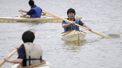 Paddle tale Hambo Xing, 18, a junior at Kiski School, paddles along with classmates on Loyalhanna Lake in kayaks they made in wood shop class.