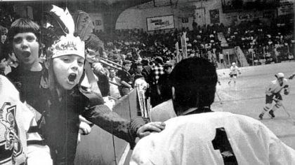 Pat on the back from young fan Juliette Slonka, age 7, gives Chiefs goaltender Bob Deraney a pat on the back as Deraney returns to the ice.