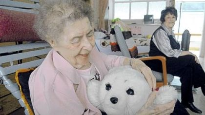 Patting Paro Millie Lesek, 89, pats Paro, a $6,000 furry robot at Vincentian Home in McCandless. At right is Eileen Oldaker, her daughter.