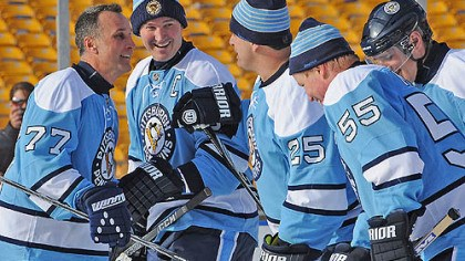 Paul Coffey, Mario Lemieux, Kevin Stevens and Larry Murphy From left to right, Penguins alumni Paul Coffey, Mario Lemieux, Kevin Stevens and Larry Murphy celebrate a goal against during Friday's game at Heinz Field.