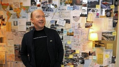 "Paul Haggis, director of ""The Next Three Days"" Paul Haggis, director of ""The Next Three Days,"" starring Russell Crowe, Elizabeth Banks and Liam Neeson, stands in front of the bedroom wall where the Crowe character makes plans and budgets to get his wife out of prison."