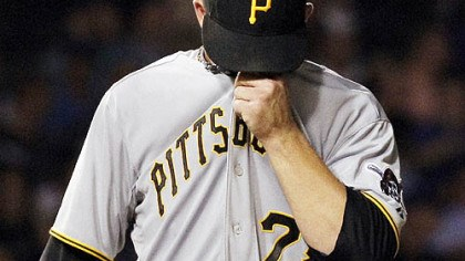 Paul Maholm The Pirates' Paul Maholm wipes his face while pitching in the second inning of the 14-2 loss Monday at Wrigley Field.