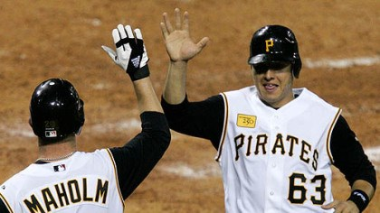 Paul Maholm and Luis Cruz Paul Maholm (28) and teammate Luis Cruz (63) score on a three-run fifth-inning double by Pirates' Nate McLouth in a baseball game against the St. Louis Cardinals at PNC Park last night.